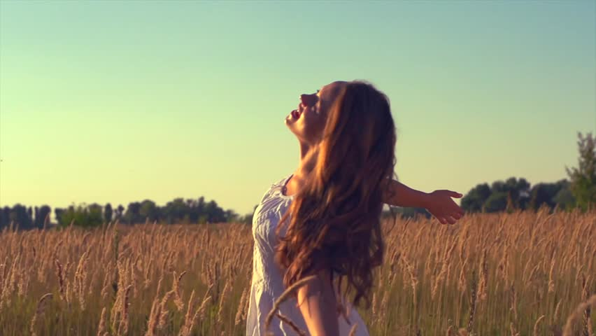 Beauty Girl with Healthy Long Hair Outdoors. Happy Smiling Young Woman Enjoying Nature. Beautiful Young Woman having Fun in the Meadow. Freedom concept. Sunset | Shutterstock HD Video #4671788