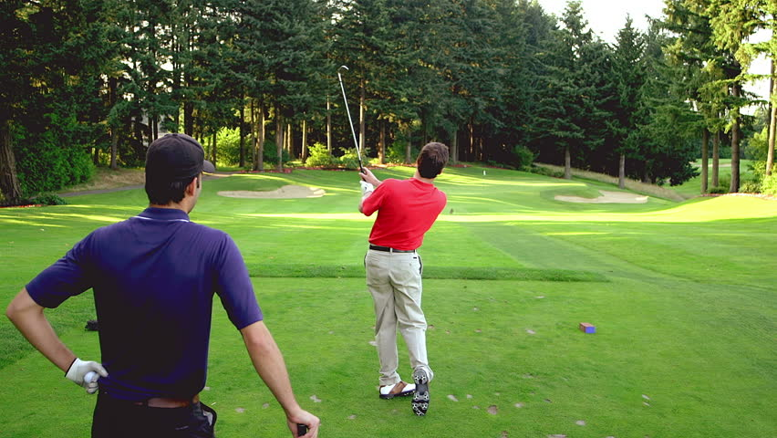 Man tees off on golf course - HD stock video clip