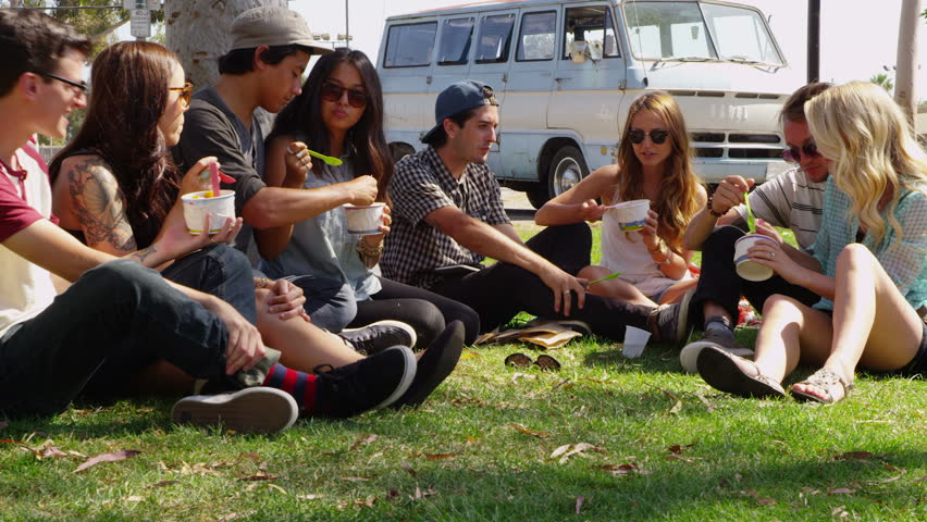 Group Of Young People Hanging Out At Park Stock Footage