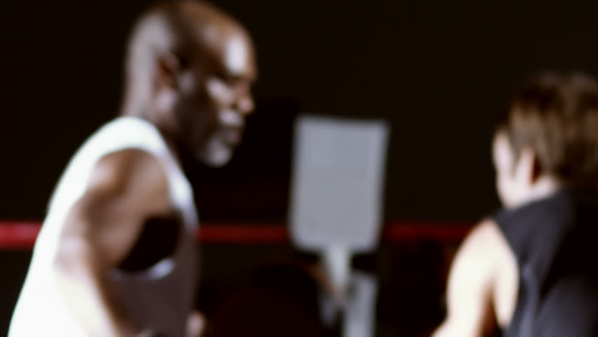 Male athlete works on his punching with a coach. Medium shot. - HD stock video clip