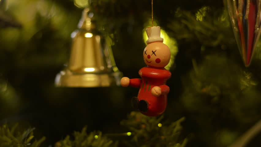 A clown and golden bell hanging on a Christmas tree. #4698806