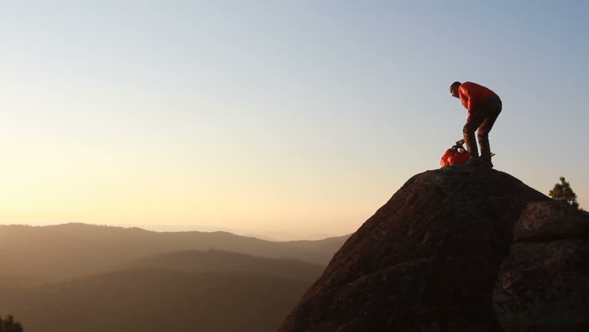 Hiker with backpack standing on top of a mountain | Shutterstock HD Video #4710092