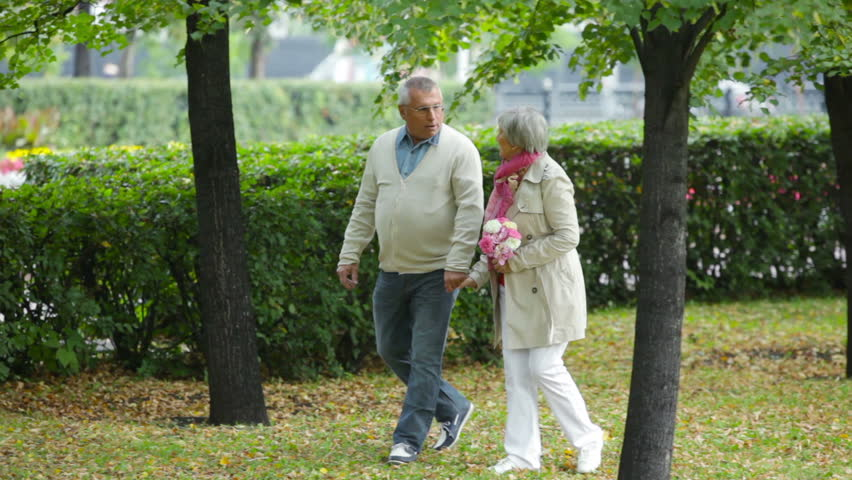 Elderly husband and wife spending their weekend in the open air - HD stock footage clip
