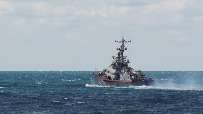 missile boat in a stormy sea - HD stock video clip