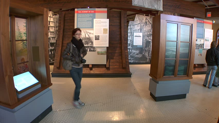 NEW YORK - CIRCA OCTOBER 2011 - Visitors look at exhibition at the Ellis Island Immigration Museum in October 2011. - HD stock footage clip