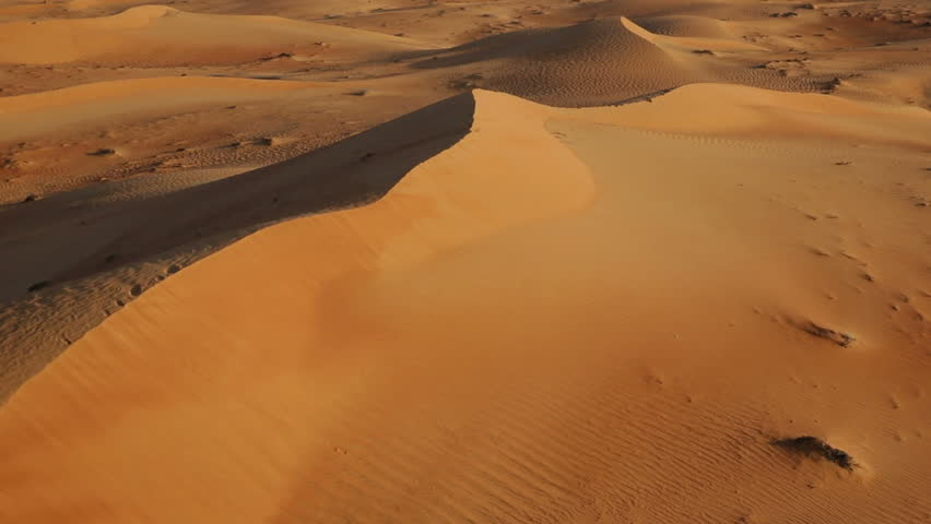 Flying over sand dunes, Aerial, Arabian Dessert, Dubai, UAE | Shutterstock HD Video #4750601