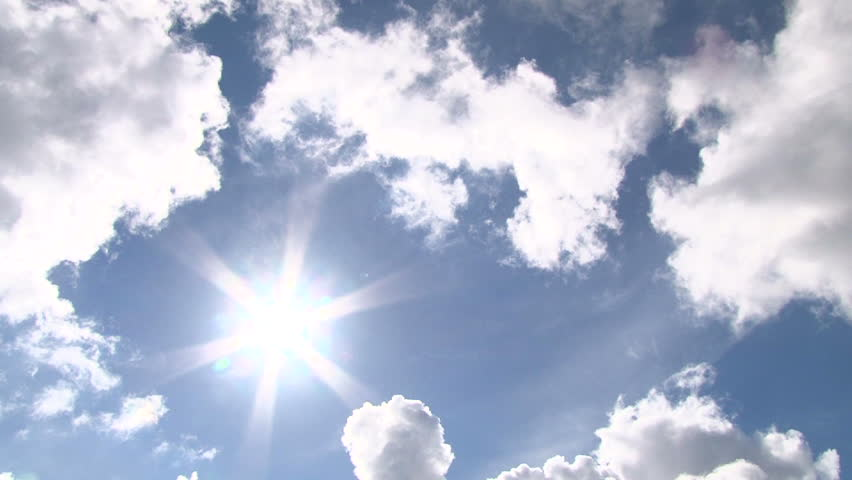 Time lapse of cloudscape with bright sun shining with clouds passing. - HD stock footage clip