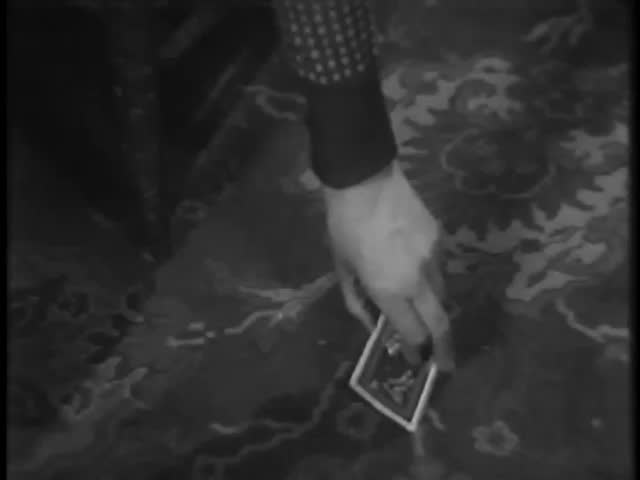 Person lifting ace of spades playing card from floor - SD stock video clip
