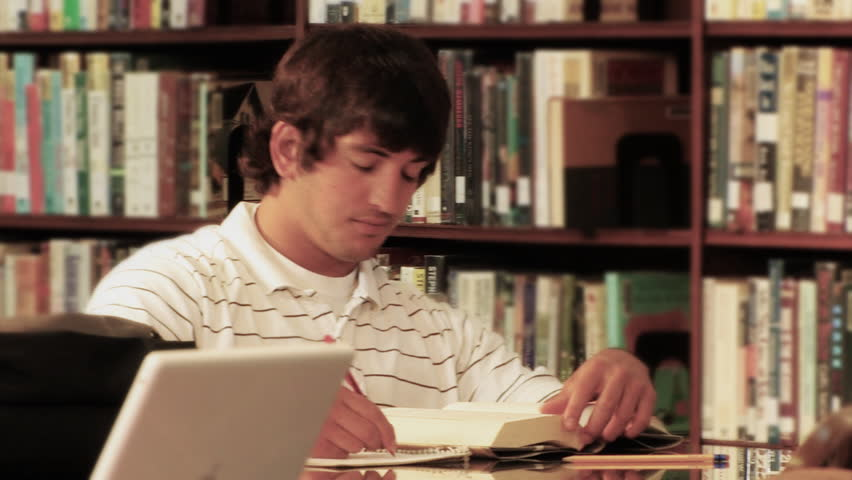 A student studies in the library. - HD stock video clip