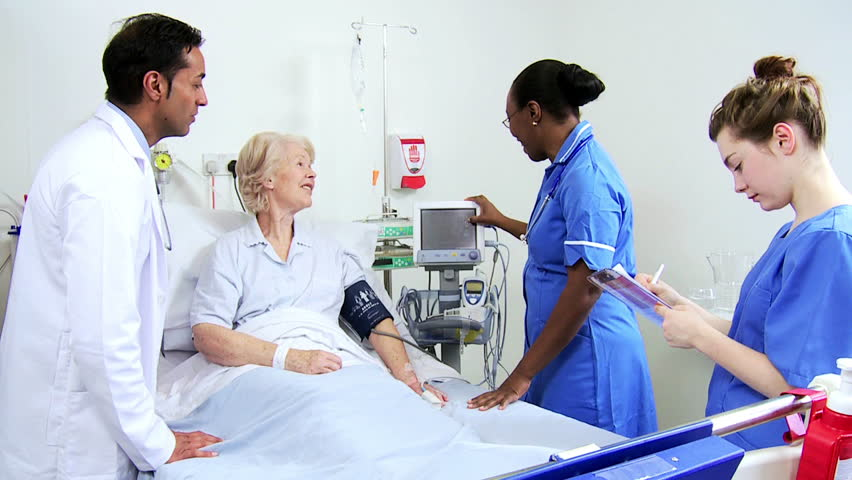 Cheerful Hospital Nurse Takes Elderly Female Patient's ...