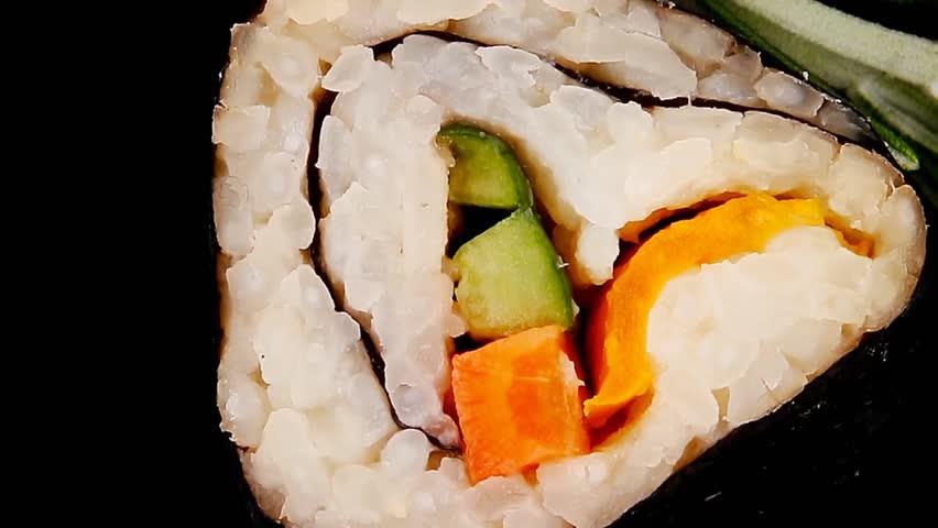Maki Rolls and California rolls made of fresh raw Salmon Tuna and Eel with Cream Cheese and Avocado . on black wooden plate . Maki Sushi and Nigiri 1920x1080 intro motion slow hidef hd