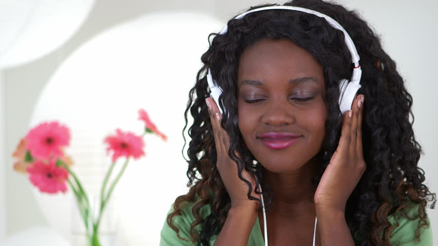 Black teenager listening to music - HD stock footage clip