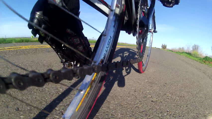 Bicycle Road Cyclist cool low angle POV point of view  of chain sprocket peddling on country road HD high definition stock video footage 1080 1920x1080 - HD stock video clip