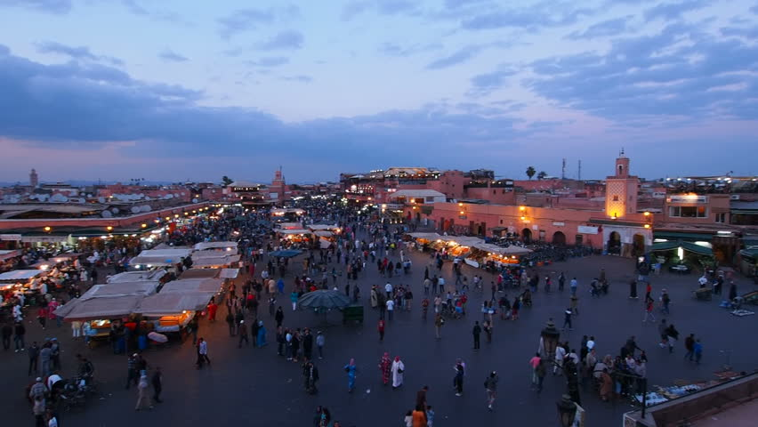 MARRAKESH, MOROCCO - MAY 03: Unidentified crowd on the Jemaa el Fna Square during the sunset on May 03, 2013 in a Marrakesh, Morocco. The square is declared UNESCO World Heritage Site.