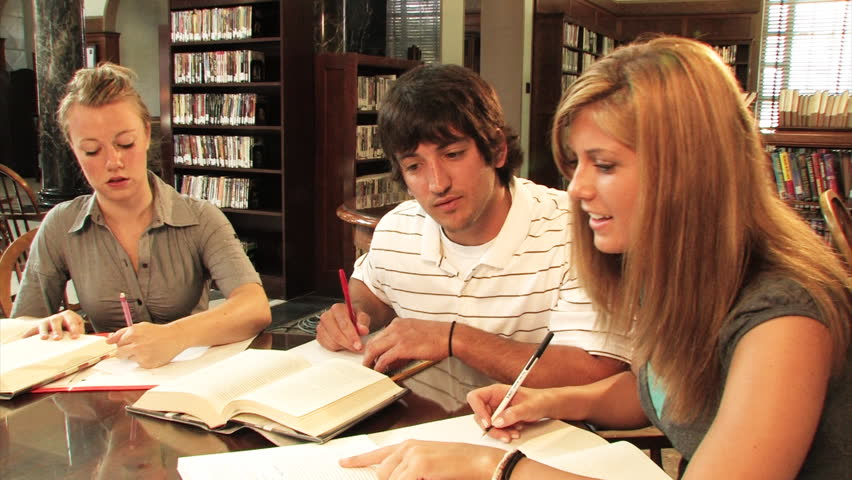 A group of students study in the library. - HD stock video clip