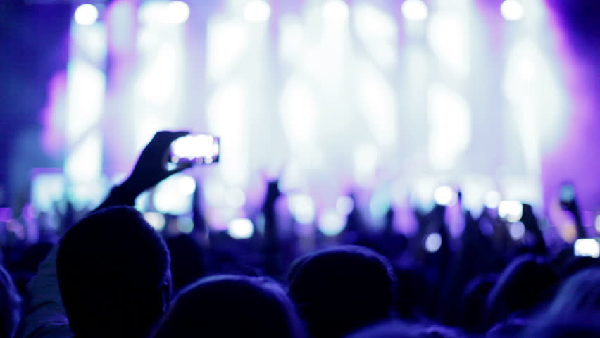 Crowd making party at a rock concert. Hands hold cameras with digital displays among people at rock concert | Shutterstock HD Video #4826759