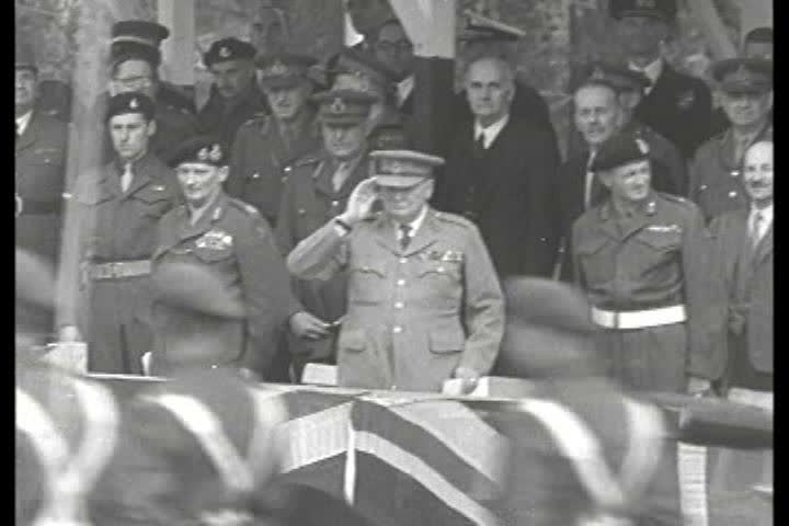 1940s - Winston Churchill salutes troops in Berlin in 1945 as allies take control of Germany.