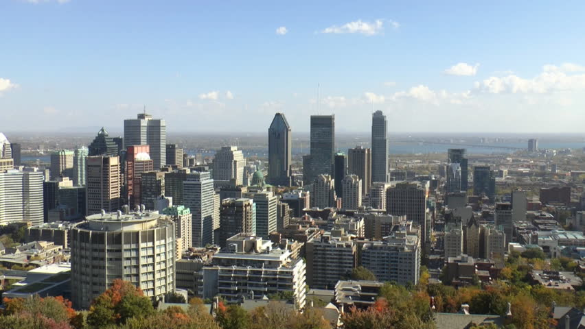 Aerial Time Lapse Of Montreal downtown skyline as seen from the lookout at Mount Royal, the St Lawrence River is visible in the distance which is part of the St Lawrence Seaway.