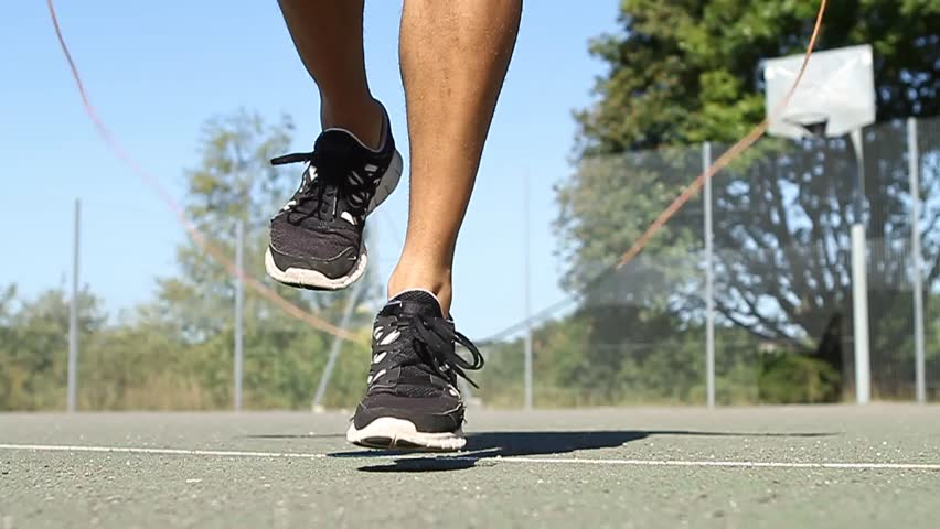 Close up of feet skipping energetically with a Skipping Rope - HD stock video clip