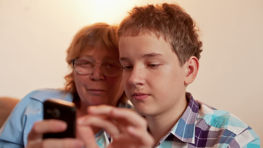 Young Boy and Old Person Learn Smartphone - HD stock video clip