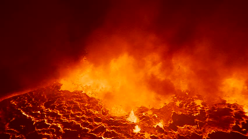The spectacular Nyiragongo volcano erupts at night in the Democratic Republic of Congo suggests the fire of hell. | Shutterstock HD Video #4875818