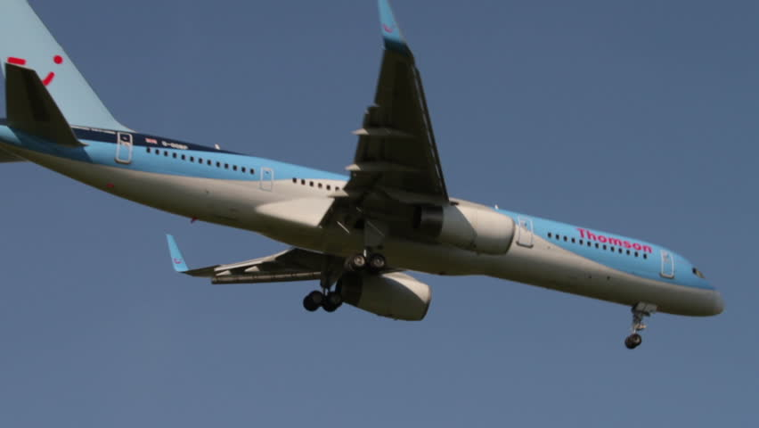 MANCHESTER, LANCASHIRE/ENGLAND - SEPTEMBER 29: Thomson jet comes in to land on September 29, 2013 in Manchester. Thomson Airways is the world's largest charter airline.