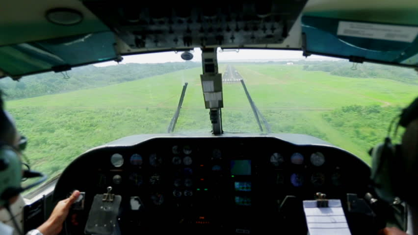 Airplane landing on small airstrip - HD stock footage clip