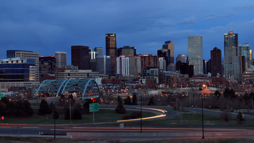 Denver skyline at dusk, with fast moving traffic on the interstate. HD 1080p