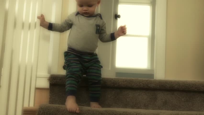A little baby boy playing on the stairs of his house | Shutterstock HD Video #4899866