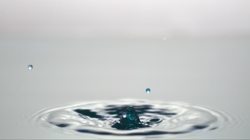 a slow motion water drop hitting another water drop, water color white/blue, shot with high speed camera Weisscam HS-2
