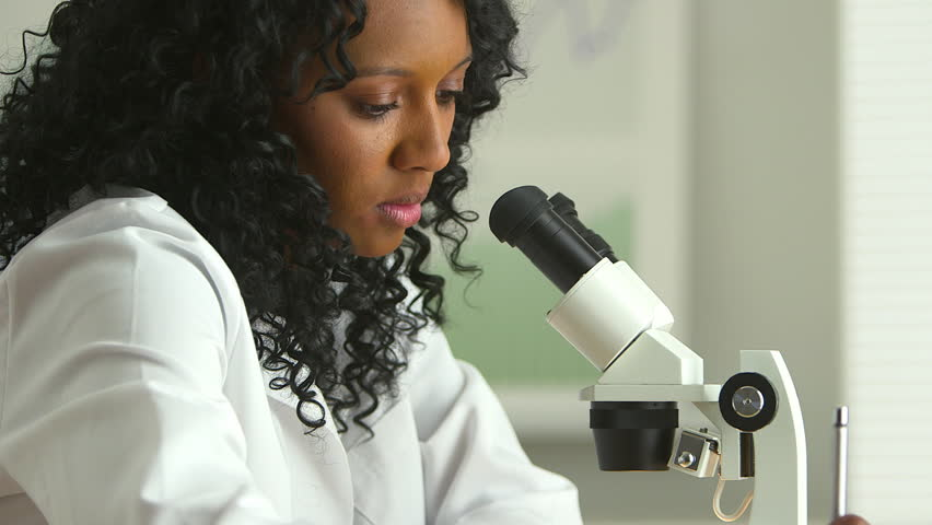 African American female medical researcher using microscope | Shutterstock HD Video #4923077