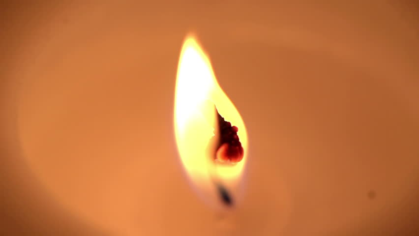 A candle is blown out in dramatic slow motion, shot at 480 frames per second. Ends in very clean darkness.