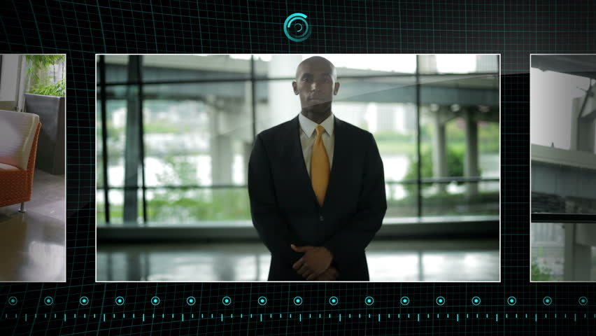 Hand scrolling on a touchscreen through clips of business people