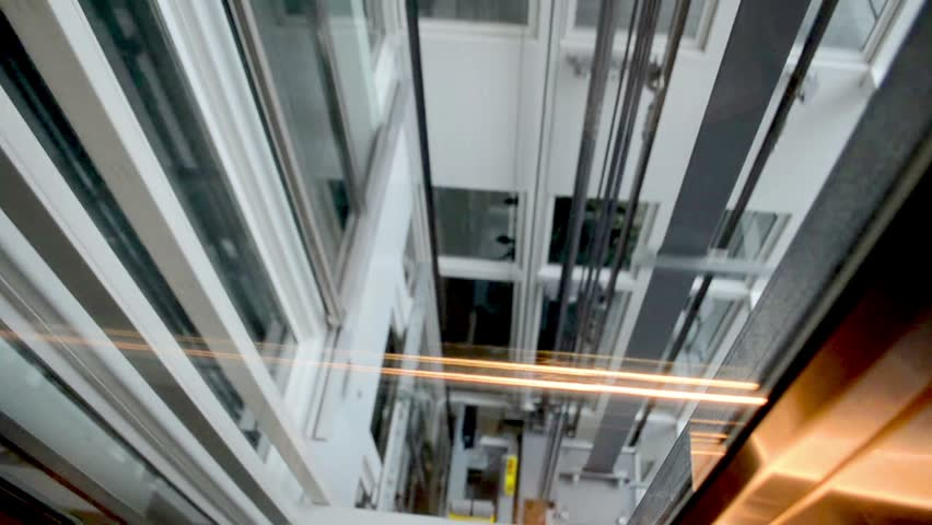 Descend down on a transparent elevator