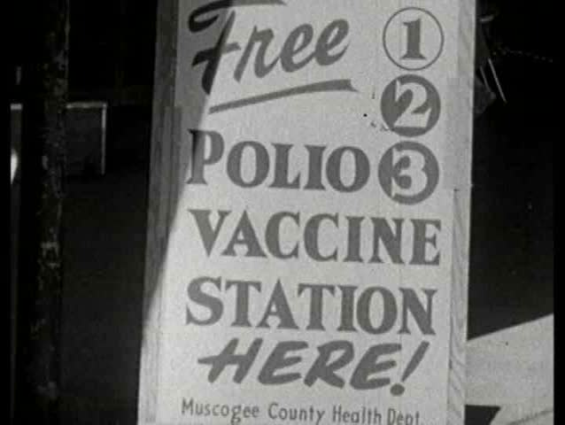 1960s - The mayor and other officials line up for immunization as well as the general population throughout the city - SD stock video clip