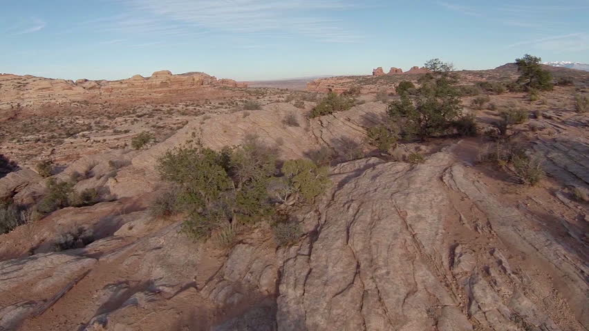 Aerial views of southern Utah Red cliffs switchback roads through the desert outside of Moab Utah.