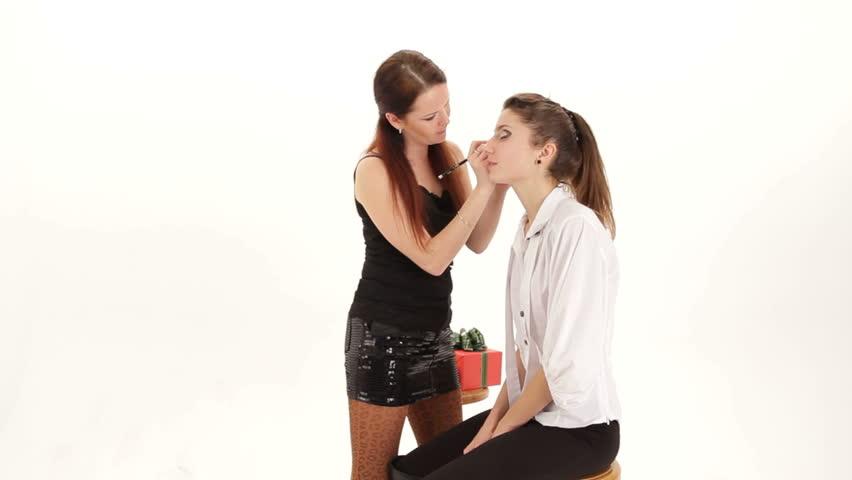 Visagist putting eyeshadows on model's eye. Putting eyeshadows. | Shutterstock HD Video #5013509
