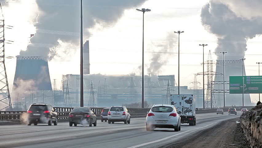 City ringway with air pollution from heat electric generation plant in Saint-Petersburg, Russia. Strong vapor and smoke due extreme cold  - HD stock video clip