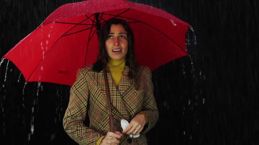 Woman Standing In Rain High-Res Stock Photo - Getty Images