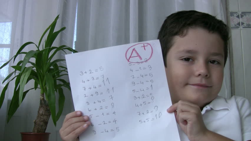 Child showing exm paper with A+ - HD stock footage clip