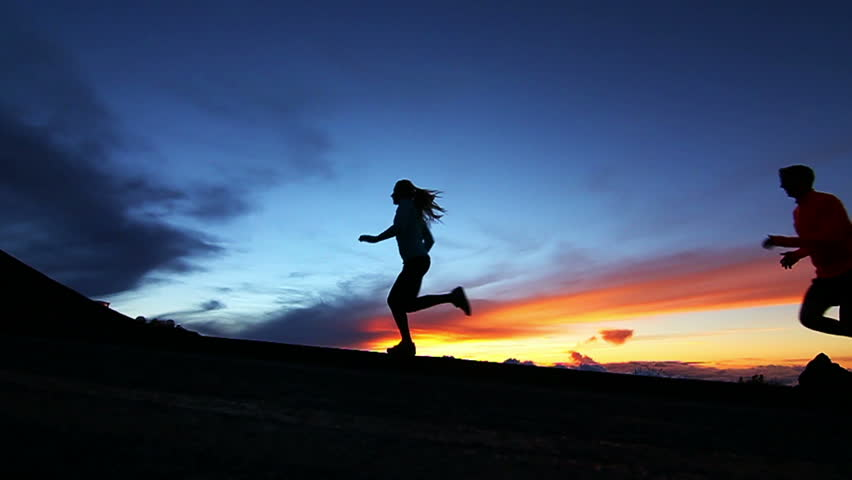 Couple running in sunset