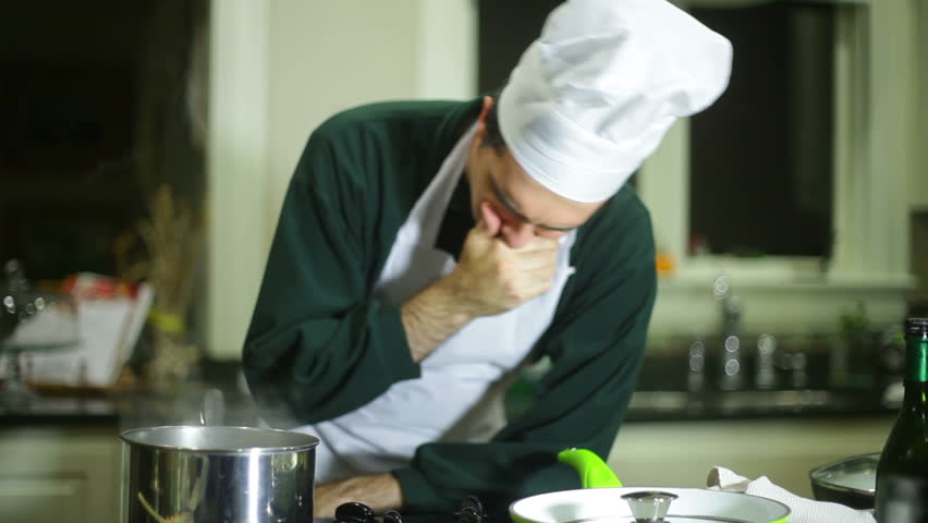 A chef smelling a pot of really bad food