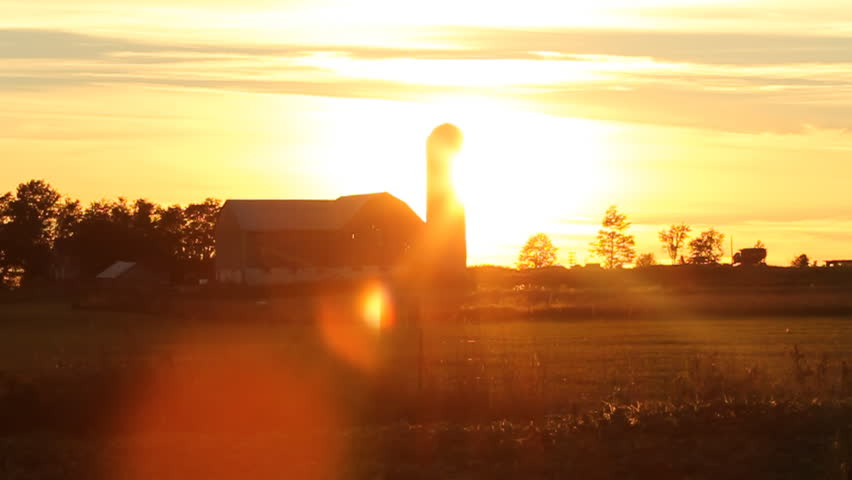 Farm at sunset. View of farm at sunset. Ontario, Canada.