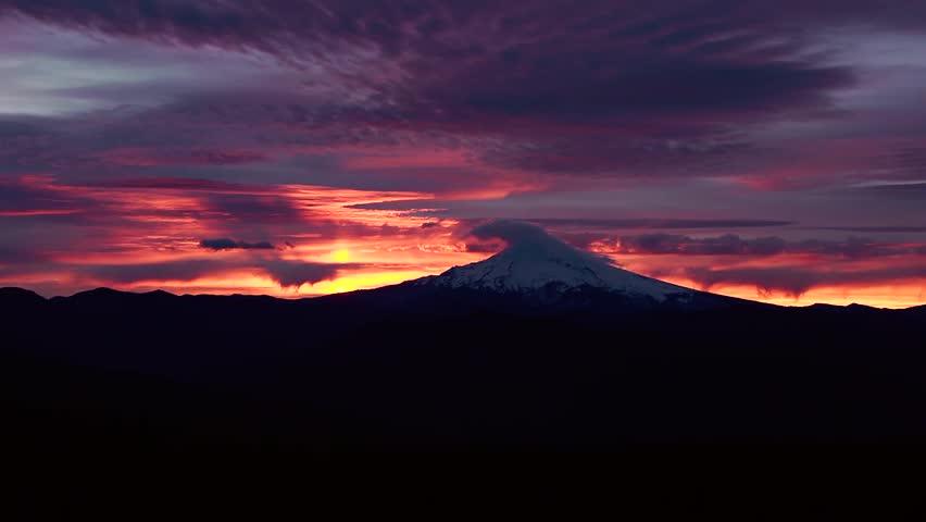 Mt Hood at Sunrise (3) - Sun Breaks Through and illuminates the clouds - HD stock video clip