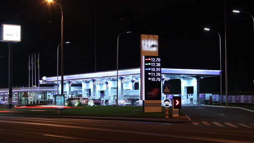 Gas fueling station night timelapse, pertrol service prices list