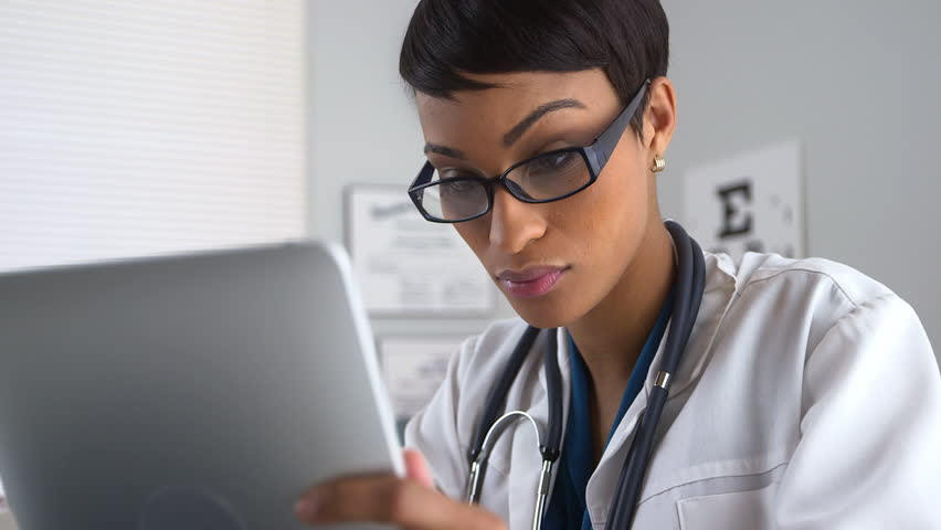 Doctor using tablet computer in office | Shutterstock HD Video #5067086