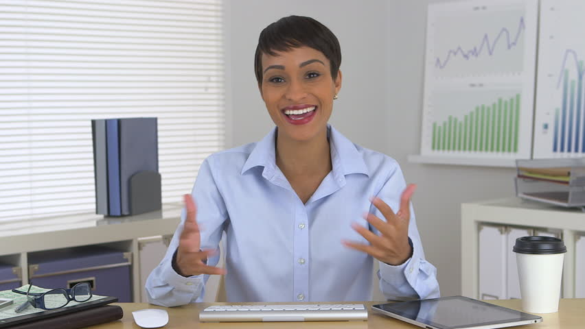 Friendly African American business woman talking to camera