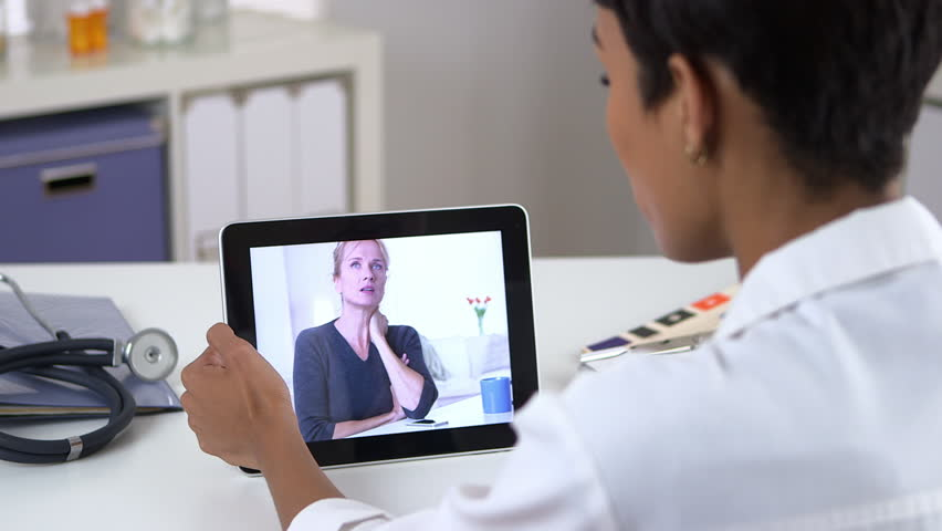 Senior patient video chatting with doctor