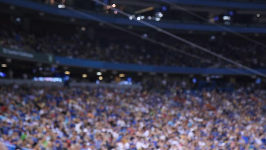 Sports stadium. Defocused. Crowd at sports stadium. Defocused.
