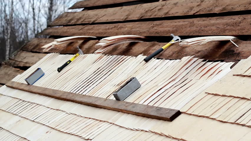 Roofer Nailing The Cedar Wooden Shingle Shake Roof Tiles